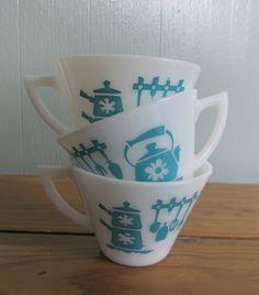 Vintage Hazel Atlas Aqua Kitchen Aids Milk Glass Coffee Mugs or Tea Cups Set of 3. $16.99, via Etsy.