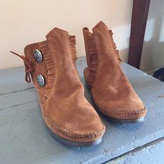 Minnetonka Urban Outfitters Leather bootie Minnetonka Urban Outfitters leather shoes that tie closed. Size 7 1/2. Never worn. Minnetonka Shoes