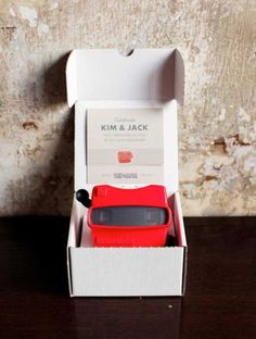 Viewmaster invitation, it would also be fun to have view masters at your reception on the tables with engagement images on them.