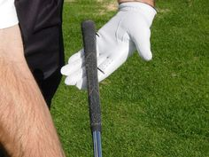 Laying the golf club across the fingers of your top hand