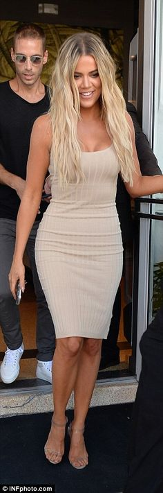Curvy display! Khloe (left) and Kourtney (right) both showed off their toned curves in body-hugging dresses