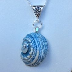 Blue porcelain sea shell necklace with mother of pearl lustre by simonesceramics on Etsy