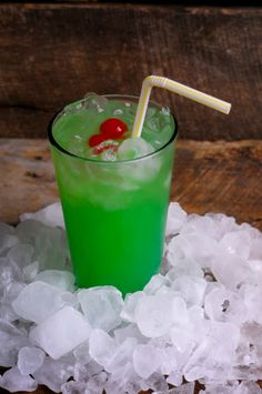 Liquid Mariguana: 1/2 ounce Malibu rum 1/2 ounce light rum 1/2 ounce blue curacao 1/2 ounce apple pucker (or melon liqueur) Equal parts sweet 'n sour mix + pineapple juice Garnish with a cherry.