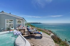 Enjoy time on the deck and in the hot tub at The Edge