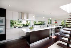 This Oatley kitchen design has captured the outdoors in the design by installing a window at the rear wall of the kitchen...