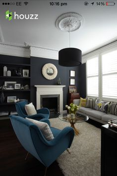 Similar layout to my living room - take note of dark colour and picture rails