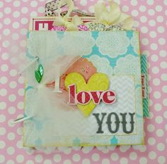 She has a great blog and this little mini album is super cute.  She shows each page.