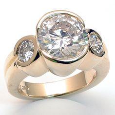 Modern Three Stone Engagement Ring!