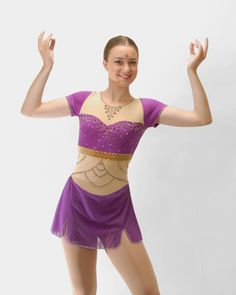 Junior/Senior Long Bollywood inspired skating dress by Cara Anne Designs. Purple short sleeve dress has gold velvet band, intricate beading design on bodice and double layer mesh skirt. Decorated with over 2000 Swarovski crystals in Amethyst, Golden Shadow, Crystal AB, Topaz, Mocha and more.
