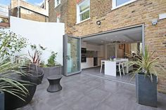 Kitchen extension ideas that spill into the outdoors bi fold doors Outdoor Spaces, Outdoor Living, Outdoor Tiles, Outdoor Flooring, Indoor Outdoor, House Ideas, Folding Doors, House Extensions, Patio Doors