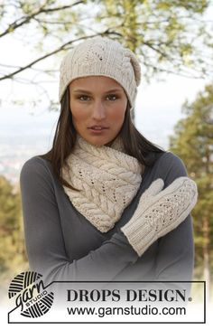 """Solveig - Knitted DROPS hat, neck warmer and mittens with lace pattern in """"Nepal"""". - Free pattern by DROPS Design"""