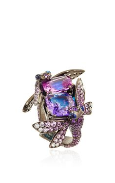 With an incessant fascination for the beautiful, the strange and the curious, this provocative ring by **Lydia Courteille** features two insects silhouettes posing over natural pink sapphires finished with diamond and sapphire details throughout.