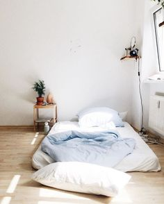 Simple, practical bedroom decor for those who don't need a lot of extras. Source: thetriangl