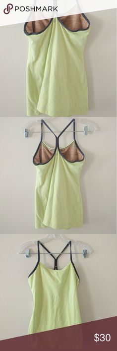 Lululemon key lime racer back tank Perfect condition, no signs of wear, built in support, no size tag, is a size 6, dark gray straps, color is a light fluorescent yellow/green lululemon athletica Tops