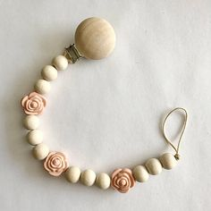 Wood and rose bead pacifier clip! Wood beads are untreated and the roses are food grade silicone. Made with organic cotton. Pacifier clip is about length. Dummy Clips, Teething Necklace, Teething Toys, Baby Crafts, Clay Jewelry, Things To Sell, Handmade Gifts, Pacifier Clips, Sweet Peach