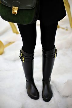 black boots with gold buckles