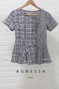 Agnessa 004 Contemporary Asymmetrical Buttoned Batik Contemporary Kawung and Checkered Combination Peplum Blouse  Length of Blouse : approx. 62 cm.  Material Used : Batik Cap, Cotton / Checkered Fabric, Japanese Cotton.
