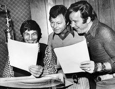 Leonard Nimoy, DeForest Kelley, and William Shatner reading something funny on the set of Star Trek