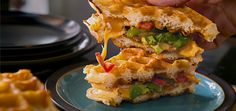 Syrup is so last season. The new way to dress up your waffle is by turning it into a glorious sandwich topped with bacon, green pepper, tomatoes, cilantro and (of course) cheese. #recipe #breakfast #brunch