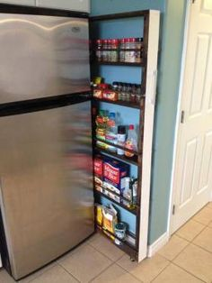 After a bit of paint, stain and hardware, our slide-out pantry was ready to be loaded up with groceries.