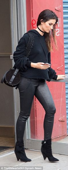 Model Lily Aldridge steps out in all black and leather