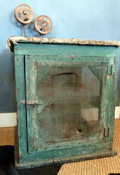 primitive painted cabinet- I love the turquoise color!