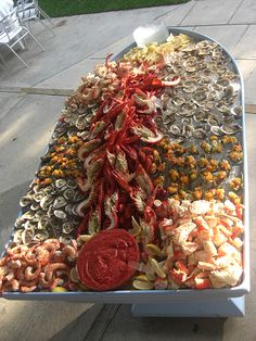 Menu: a splurge item, but easy to serve. Make a small scale version of this Seafood Boat Buffet. You can find La Mer tiered trays at restaurant supply stores, DIY ice bowls (find instructions on martha stewart) or an old galvanized tub or buckets.