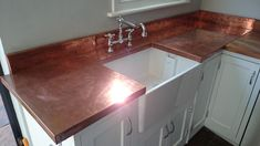 Copper at Tipfords- We provide bespoke design at an affordable price. Our lovely items include Copper Worktops, Copper Window sills, bespoke furniture and Home accessories. Copper Splashback Kitchen, Copper Countertops, Kitchen Worktop, Kitchen Countertops, Dining Room Sets, Black And Copper Kitchen, Copper Work, Bakery Kitchen, Freestanding Kitchen