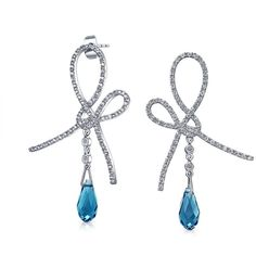 Bling Jewelry Bling Jewelry Simulated Topaz Cz Pave Ribbon Drop... (£23) ❤ liked on Polyvore featuring jewelry, earrings, blue, long earrings, long drop earrings, long chain earrings, bridal drop earrings and blue drop earrings