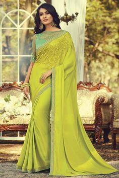 Online Shopping of Art Silk Fabric Party Style Yellow Color Fancy Saree With Embroidered Blouse from SareesBazaar, leading online ethnic clothing store offering latest collection of sarees, salwar suits, lehengas & kurtis Bollywood Sarees Online, Green Saree, Green Blouse, Party Wear Sarees Online, Green Silk, Teal Green, Yellow, Art Silk Sarees, Fancy Sarees