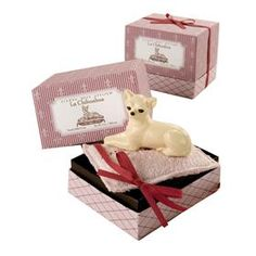 Our little soap princess chihuahua, rests upon a soft terry bath sponge. This French-milled soap is scented with crisp delicate notes of lily, mimosa, tuberose, and violet. Both pup and throne come nestled in a chic gift box fit for canine royalty.