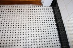 basket weave tile with black cove tiles against wall