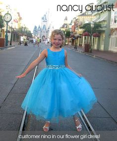 #Turquoise #FlowerGirlDress with Rhinestone And Tulle Skirt: This gorgeous turquoise rhinestone flower girl dress features a taffeta bodice and tulle skirt with additional netting underneath for a full volume ballerina skirt look. The waistline is embellished with elegant rhinestone jewels, delicate beading, and sequin. Your little princess will be the belle of the day in this alluring turquoise blue flower girl dress.