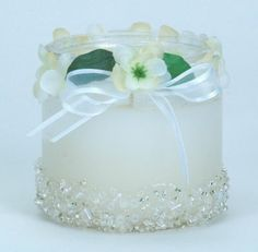 Bridal Candle:  Create this beautiful beaded candle jar to use as a reception decoration or favor. Beacon Gem-Tac Adhesive attaches both the beads and silk flowers to the glass jar perfectly.
