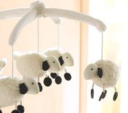 adorable sheep mobile!  and i love that it's black and white!  even better! Where's the black sheep..