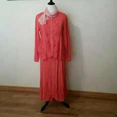Stunning 2 pc. Skirt set with scarf Elegant embroidery embellished the front of the blouse and bottom of skirt along with the hems of the weskit hemmed blouse and long sleeves. Beautiful coral color. Skirts Midi