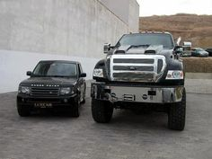 Ford F650 next to a Land Rover... haha that's flippin sweet haha.. the land rover is so tiny haha