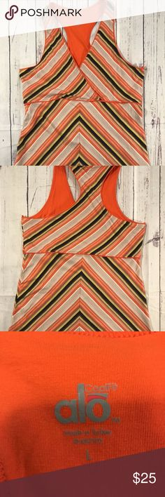 Alo Yoga Cool Fit Stripe Tank Top Size Large Racer Alo Yoga Cool Fit Striped Tank Top Size Large Racer Back Slight washer wear as it is pre-owned.  Made in Turkey  Cotton and Spandex Fibers  Pet friendly and smoke Free home ALO Yoga Tops Tank Tops