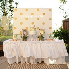 Love the idea of using a canvas as a backdrop! Color scheme is great too.
