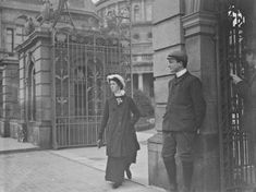 Woman walking through the gates of Leinster House, Kildare Street. National Library of Ireland in the background. Ireland Pictures, Images Of Ireland, Old Pictures, Old Photos, Vintage Photos, Irish Independence, Ireland Homes, Digital Archives, Emerald Isle