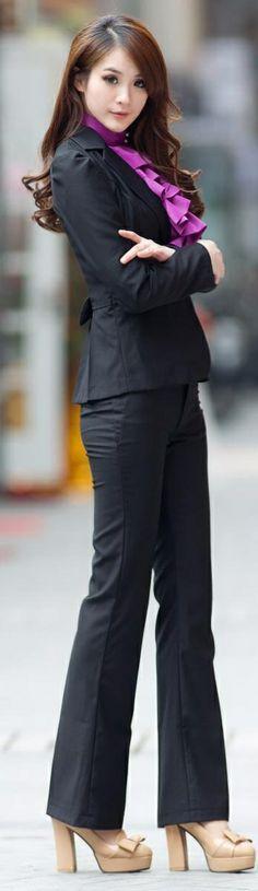 Black pantsuit w/purple blouse.