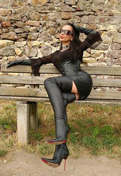 Young woman wears thigh high leather boots (i love boots)
