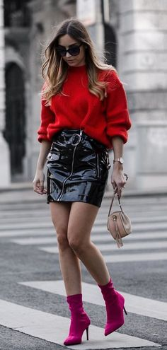 Red sweater belted black patent leather skirt and fuchsia ankle boots