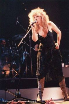 Stevie ~ ☆♥❤♥☆ ~ onstage, left hand on her left hip, looking like she owns the stage, and as the foxy front woman and prolific song writer that she was and still is, she earned that spot