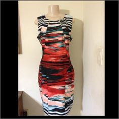 Calvin Klein multicolor dress Calvin Klein multicolor dress.  Size 6.  Vibrant colors and looks great on.  Gently used.  Worn a handful of times Calvin Klein Dresses