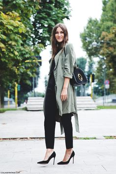 Dress to impress in an army green trench and black suit pants. Finish off your look with black suede pumps.  Shop this look for $139:  http://lookastic.com/women/looks/pumps-dress-pants-turtleneck-crossbody-bag-trenchcoat/3968  — Black Suede Pumps  — Black Dress Pants  — Black Turtleneck  — Black Suede Crossbody Bag  — Olive Trenchcoat