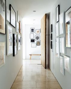 Wall Treatment - A bench amid a hallway's gallery walls hung with framed art
