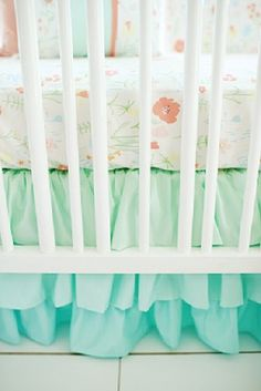 Our Ombre Ruffled Crib Skirt features hues of aqua and mint! Our Spring Floral Crib Collection is perfect for your Mint Nursery!