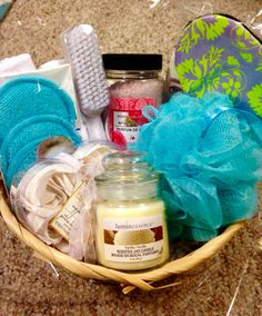 $10 Spa themed Dollar Store gift basket for gift exchange: loofah, microfiber washcloths, microfiber facial scrubbers, soap rose petals, rose scented bath salts, vanilla candle, eye mask, pumice stone/nail scrubber.