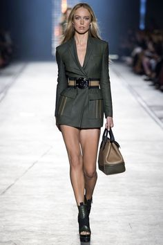Versace may be synonymous with flash, sex and swagger, but when Donatella decides to do reserved it can be just as much of a statement. For Spring, Versace tapped a military beat. One that was tailored, cool and young.    - HarpersBAZAAR.com